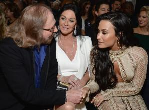 LOS ANGELES, CA - FEBRUARY 12: (L-R) Recording artist Barry Gibb, Linda Gray, and recording artist Demi Lovato attend The 59th GRAMMY Awards at STAPLES Center on February 12, 2017 in Los Angeles, California. (Photo by Michael Kovac/WireImage)
