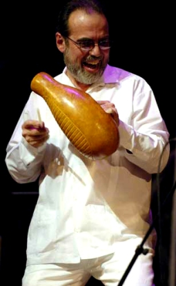 """CHICO ÁLVAREZ playing a """"guiro"""" and leading his Orchestra at a World Music Institute """"Noches Cubanos"""" concert at Skirball Center, NYU, New York City, Saturday, 04-16-2005. CREDIT: Photograph © 2005 Jack Vartoogian/FrontRowPhotos. ALL RIGHTS RESERVED."""