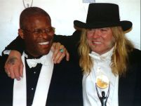 Gregg Allman (R) of the Allman Brothers Band poses with band drummer Jaimoe after they were inducted into the Rock and Roll Hall of Fame in ceremonies in New York January 12