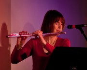 Patricia Julien in red w her flute Queen City Bossa