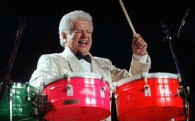 Tito Puente playing timbales photo by Joe Conzo