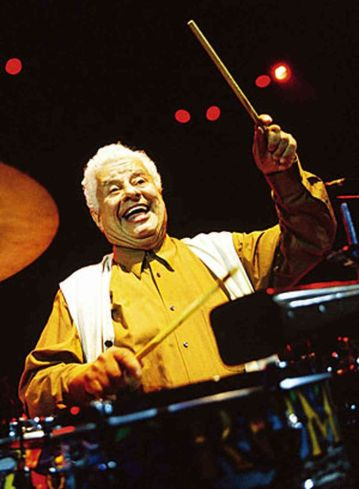 Tito Puente Sr. happy and in yellow
