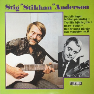ABBA'S MANAGER Stig Anderson w guitar