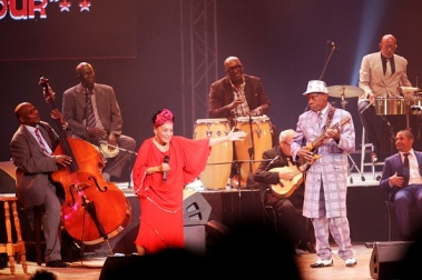 "HAVANA, CUBA - MAY 15: Cuban singer Omara Portuondo performs with Papi Oviedo (R) and the Buena Vista Social Club Orchestra as the final curtain falls during the last concert of its ""Adios"" tour, officially bidding farewell, in the Teatro Karl Marx, on May 15, 2016 in Havana, Cuba. The Buena Vista Social Club Orchestra grew out of its 1997 release of the Grammy winning album and documentary film Buena Vista Social Club by Wim Wenders and has toured worldwide for over 16 years. Portuondo is only one of four surviving members of the original Buena Vista Social Club project. (Photo by Sven Creutzmann/Mambo Photo/Getty Images)"