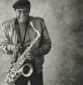 Stanley Turrentine smiling w his tenor sax 1