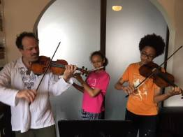 The Huebners practicing for the El Violin Latino Vol III