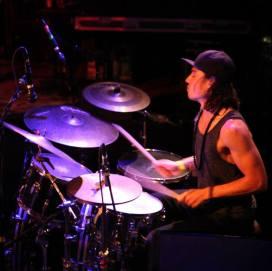 Walker Adams playing his drums