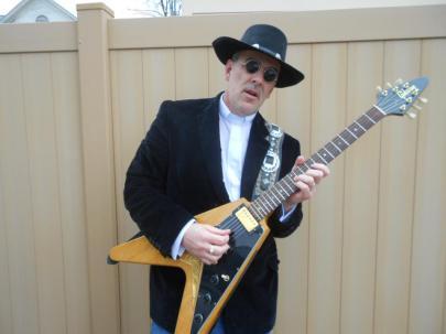Missisquoi Slim w hat and guitar